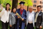 photo: Russell Kim stands with his family on graduation day