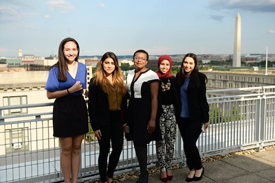 Five Students pose on Elliott School balcony for PPIA public service weekend