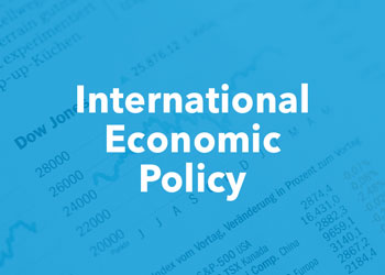 International Economic Policy - photo of investment report with blue overlay