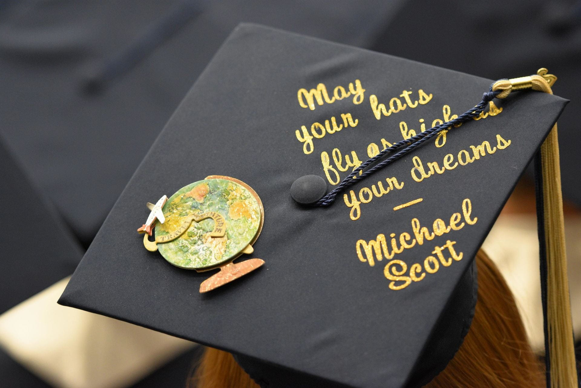 "Photo of graduation cap with the Michael Scott quote, ""May your cap fly as high as your dreams"""