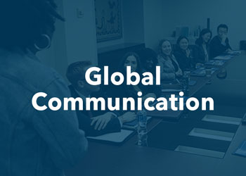 Global Communications - students speak in a conference room with blue overlay