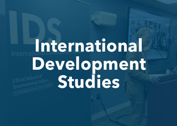 International Development Studies - photo of the Director of the IDS program speaking at an event with blue overlay