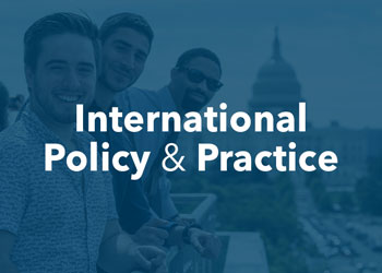 International Policy and Practice - photo of graduate students smiling with view of the US Capitol in the background with blue overlay