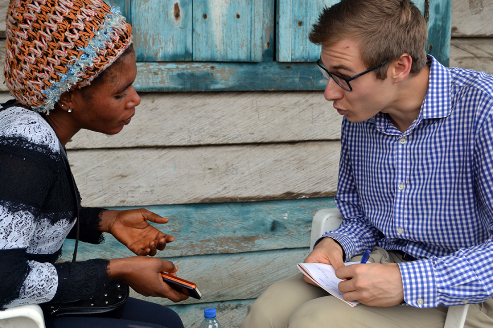 photo: Elliott School student Max Bone interviews a Cameroonian woman