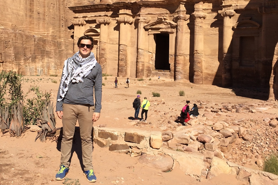 photo: Elliott School student Nicolas Reeves poses in front of Petra in Jordan