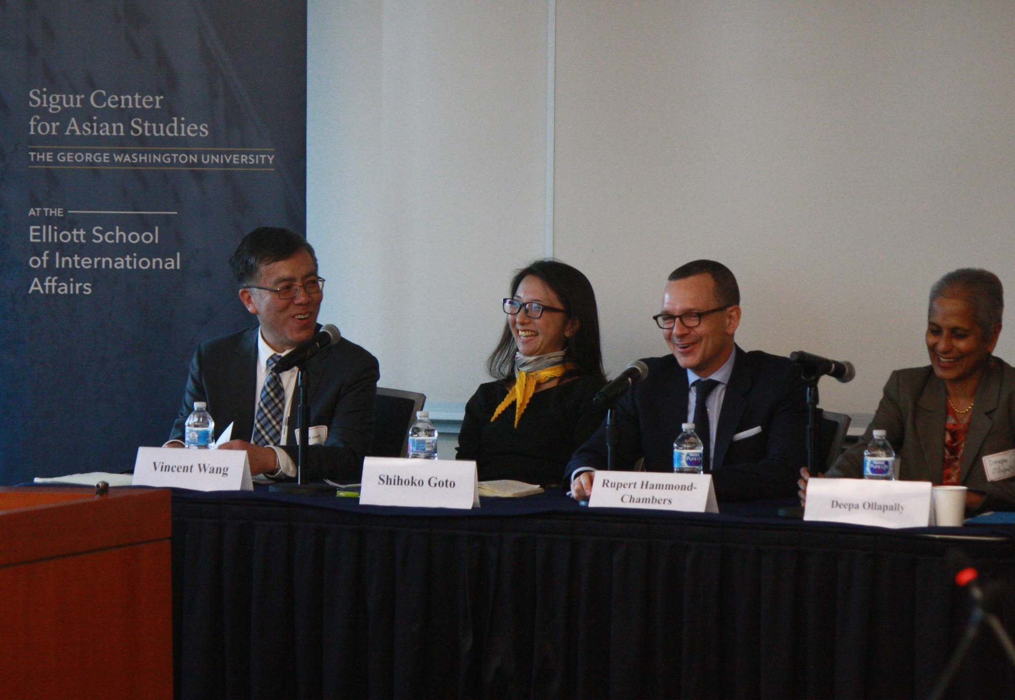 photo: a panel at the front of an event