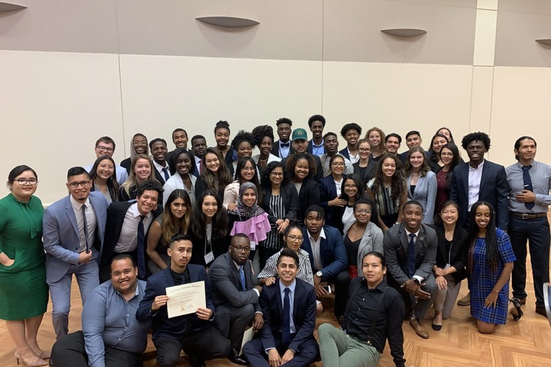group of students from the 2018 public service weekend smiles for a photo