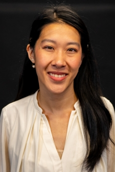 Photo: Headshot of Helen Jiang in front of a black background