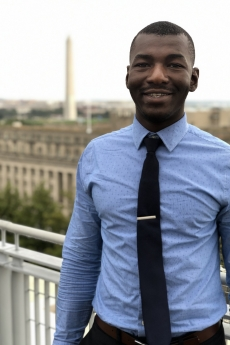 Photo: Portrait of Siaka Togola in front of the Washington Monument from the balcony of the Elliott School