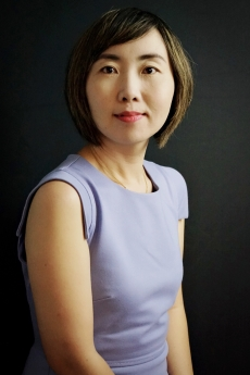 Maggie Xiaoyang Chen, pictured in professional attire